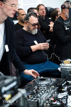 Michel Gaubert waiting for the Chanel show to start.