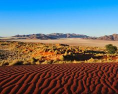 Most pristine places in the world. With giant dunes, ancient petroglyphs, craters and waterfalls, Namibia is one of the most untouched landscapes in Africa. It's also one of the only countries to preserve the health of its ecosystem in its constitution.