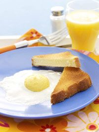 April Fool's Breakfast - marshmallow and frosting egg with pound cake toast