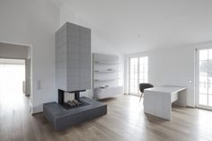 Penthouse: Beautiful White Themed Penthouse V Interior Design in Austria By Destilat, Spacious Living Space in Penthouse V in Austria showing White Workdesk and Fireplace and Wall Mounted Shelf Unit also White Wall Paint Color and Laminate Wood Flooring By Destilat