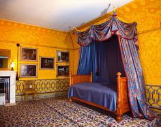 Photograph of the Yellow Bow Room (North), furnished with a satinwood bed. The red vase and flower chintz draperies were reconstructed using an original James Arrowsmith design of Royal Bedroom, Royal Pavilion, Royal Furniture, Brighton And Hove, Gold Walls, Luxurious Bedrooms, Ground Floor, Colorful Interiors, House