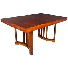 Art Deco Extension Dining Table in Mahogany with Opposing Arc Form Base | From a unique collection of antique and modern dining room tables at https://www.1stdibs.com/furniture/tables/dining-room-tables/