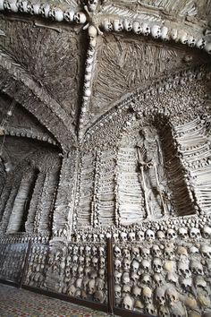 "Listed as the ""Bones Church, Evora, Portugal."" Stacked creatively from floor to ceiling with human bones. A capela dos ossos em Évora, Portugal. Memento Mori, Sedlec Ossuary, La Danse Macabre, Prague Czech Republic, Spain And Portugal, Skull And Bones, Kirchen, Skulls, Places"
