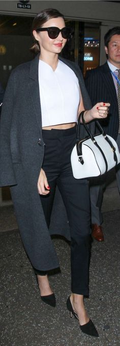 Who made Miranda Kerr's black sunglasses, gray coat, pumps, white crop v neck top, and white handbag? Miranda Kerr Style, Celebrity Style Casual, Australian Models, White Handbag, White Pumps, Black Sunglasses, Well Dressed, V Neck Tops, Girl Crushes