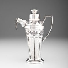 Columbian, ca 1940. Silver cocktail shaker with hammered surface and geometric pattern, marked for Arturo Medina, a mid-century silversmith ...