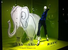 this display makes a BIG impact - a mannequin, signage and a creative use of foam core
