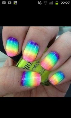 Rainbow nail on ring finger and all the tips in sparkling pink