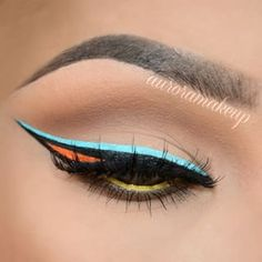 Watch Aurora paint this vivid picture on her YouTube channel. | Colorful Graphic Eyeliner Is The Way To Take Your Look To New Levels