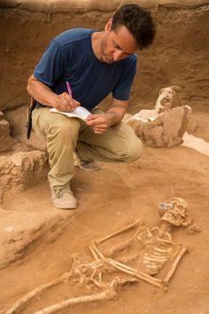 Assistant excavation director Adam Aja documents a burial in the first Philistine cemetery ever discovered, at the site  of Ashkelon in southern Israel.