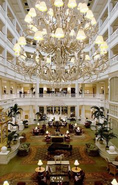 The breathtaking 5 story high atrium lobby is capped with light filtering stained glass domes. Grand Floridian