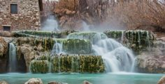 Picture of Thermal water for bathing.Saturnia, famous in Tuscany stock photo, images and stock photography. Swimming Pool Pond, Swimming Holes, Italy Location, Pond Fountains, Wassily Kandinsky, Water Features, Waterfall, Spa, Stock Photos