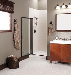 Gray bathroom, white shower, dark fixtures, walk in shower.