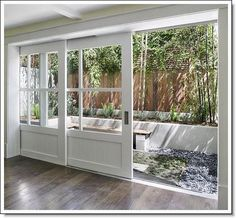sliding barn doors...awesome... if only I had a pond in my backyard. Yesterday's rain puddles don't qualify.
