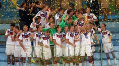 Lukas Podolski  of Germany lifts the World Cup trophy