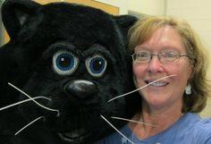 The Cat's Meow Village owner, Faline Jones, with the Village Mascot, Casper.
