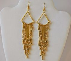 With cascading strands of gold beads and chain, the Gorgeous Golden Chandelier Earrings are an elegant and chic DIY earrings set.
