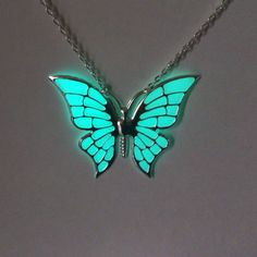 Hey, I found this really awesome Etsy listing at https://www.etsy.com/listing/221346102/aqua-butterfly-glowing-necklace-glowing