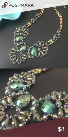 NWOT beaded statement necklace Multi color gorgeous statement necklace for day or night! Have questions on the size? Ask! I'm happy to provide all measurements! ALL JEWELRY BUY 3 GET 1 FREE! Jewelry Necklaces