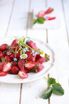 lovely plate of strawberries with edible flowers