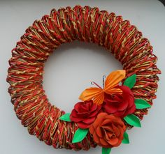 This wreath is made from newspaper.  Roses are made from toilet paper rolls: http://www.askarteluideoita.fi/askartelu/kukkia-eri-materiaaleista/