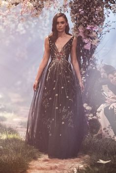 PSS/S1828 – Tulle caped gown inspired by the Kiss of True Love, featuring heart and crown embroidery and passages from Sleeping Beauty