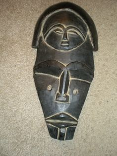 """ARTFINDER: ZIMBABWE III by S. Theodore Lymon - A hand carved, hand painted, wooden African art work. This is a sculptural abstract """"portrait"""". It is similar to the  African masks I created. It was also in..."""