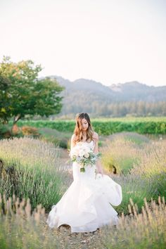 Photography : This Love of Yours Photography | Wedding Dress : Monique Lhuillier | Floral Design : Vanda Floral Design Read More on SMP: http://www.stylemepretty.com/2016/11/04/outdoor-sonoma-county-sophisticated-film-winery-wedding/