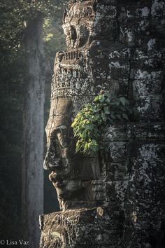 Pouting in Cambodia - The 12th century Khmer Bayon Temple in Cambodia is known for its awsome smiling faces. It's part of the largest Hindu-Buddishm Sanctuary in the World, Angkor. Siem Reap, Cambodia