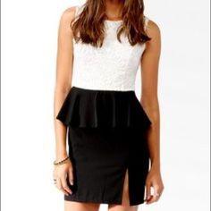 Dress With Peplum And Small Slit