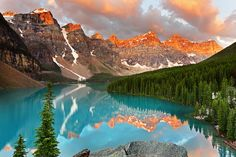 Alberta, Canada Moraine Lake is fed by glacial waters and gets a pretty shade of blue from the rock flour that deposits from erosion.