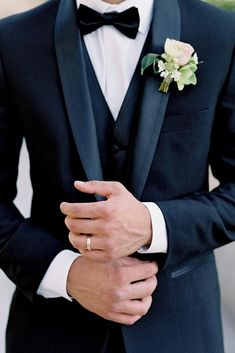 besame wedding styled shoot groom with a butterfly in a black suit with a waistcoat and a buttonhole of roses on his finger a simple gold ring carrie king photographer wedding groom attire Tuscan Inspired Wedding Style Shoot Black Suit Wedding, Wedding Men, Wedding Shoot, Wedding Attire, Wedding Styles, Wedding Ideas, Mens Wedding Style, Men Wedding Fashion, Wedding Suits For Groom