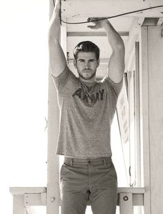 Liam Hemsworth. All I know is he's VERY attractive...& his brothers aren't painful to look at either.
