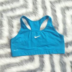 Nike Dri-fit Sports top Nike dri-fit sports top. Perfect for your fitness clothing collection. Bright and cheerful color!  Good condition, worn once  Pic #3 inside front Pic #4 inside back Size large ***no size tag attached*** Nike Tops