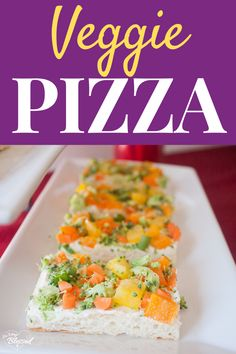 This Veggie Pizza is a crescent roll crust topped with cream cheese and a variety of vegetables, making it a healthy appetizer and perfect party food! #veggiepizza
