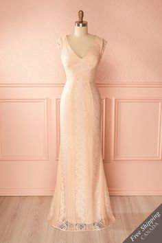 Mortizia #Boutique1861 / There's nothing like draping yourself in delicate lace to make you feel fabulous! This lovely spring gown with V-neck and mermaid cut will hug your curves and show you off. Your back can be seen through the lace, giving you an air of romance and mystery. You'll look like a fairy queen at your next springtime event!