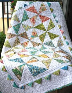 Pinwheel and Prairie Point Baby Quilt - via @Craftsy