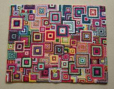 Etsy vendor CresusArtisanat (from Tokyo!) made this hooked rug using upcycled t-shirt fabric, with inspiration from Kaffe Fasset.