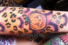 Leopard AND Halloween tattoo! Unique.. But i would get for my obsession with leopard print and the pumpkin because my birthday is in October.