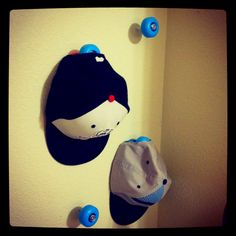 Skateboard wheel hat hooks