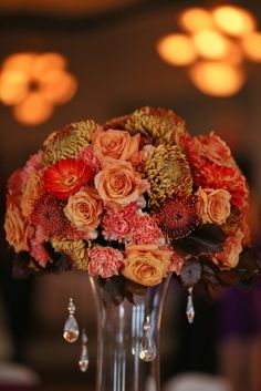 Red Wedding, wedding reception flowers, centerpieces, table decor, Photographs by Eric Camping, Floral Designs by Stacy K Floral