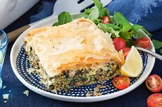 Greek lamb and spinach pie - Crisp golden flaked pastry tops this Greek-style lamb and spinach pie.