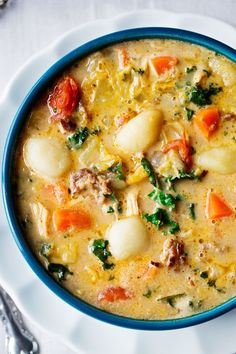 Creamy Sausage, Turkey and Gnocchi Soup - This fragrant soup is made with coconut milk, Italian sausage, turkey, oodles of vegetables and gluten free gnocchi. The smell is amazing!!!