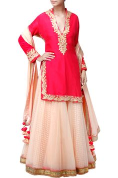 Featuring a fuchsia full sleeved cut out back kurta based in silk with embellished neckline and border. It comes with a salmon pink flared lehenga skirt based in net with gold embellished border. It is paired with a salmon pink georgette dupatta with embellished border and tassels. Fabric: Silk, Georgette, Net Care Instructions: Dryclean only.