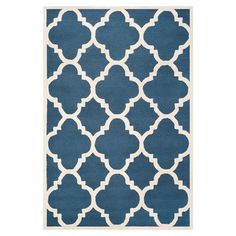 Hand-tufted wool rug in navy with a quatrefoil motif. Made in India.  Product: RugConstruction Material: Wool