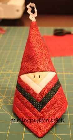 Log cabin Santa ornament tutorial (It would be neat to do it with the hat in a different fabric so that in that back it is more obviously a stocking cap.  Then one could add a pompom to the bottom of it.