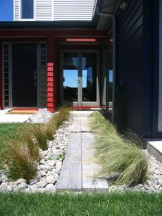 Coastal Garden landscaping rocks and native New Zealand grasses