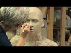Tip Toland sculpting a bust at Seward Park Clay Studio