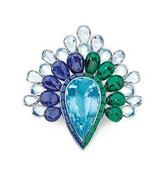 Prince Dimitri - A pear-shaped aquamarine is set among emerald, sapphire, moonstone, and diamond petals in this colorful brooch.