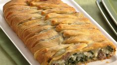 Dress up Italian sausage with spinach and cheese in a pretty crescent package.