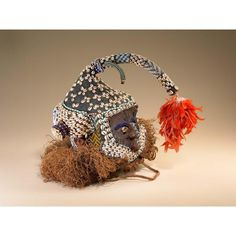 Africa | Kuba people Cap Mask.  This mask was photographed Life magazine photographer Eliot Elisofon, while being danced in Muenshi village in 1972. Made of cloth, fiber, glass beads and cowrie shells.